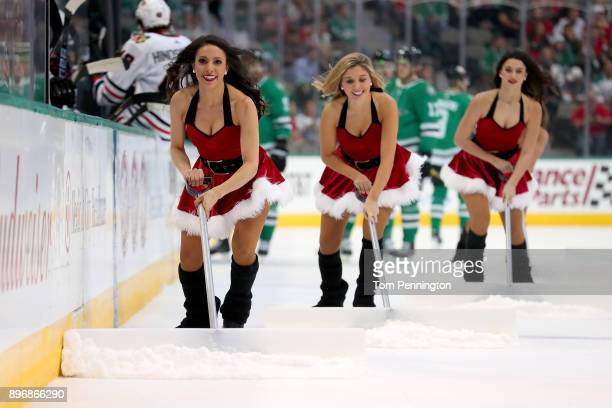 The Dallas Stars Ice Girls clear the ice as the Dallas Stars take on the Chicago Blackhawks at American Airlines Center on December 21 2017 in Dallas...