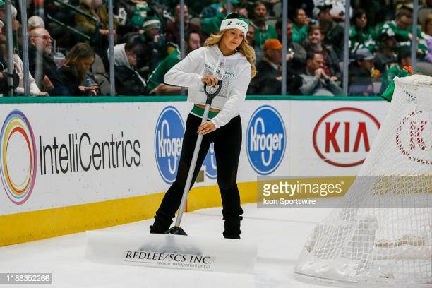 The Dallas Stars Ice Girls clear the ice during the game between the Dallas Stars and the Vegas Golden Knights on December 13 2019 at the American...