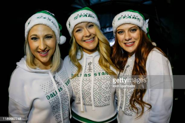 The Dallas Stars Ice Girls pose for pictures during the game between the Dallas Stars and the Vegas Golden Knights on December 13 2019 at the...