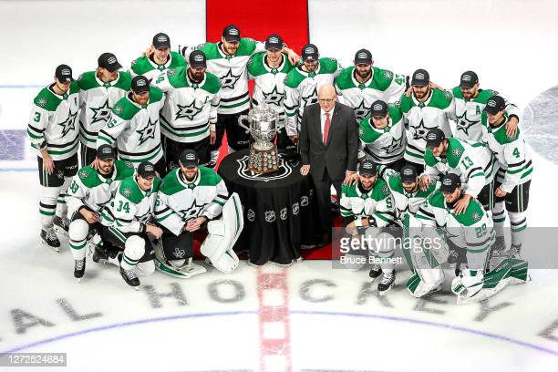 The Dallas Stars pose for a team photo with Bill Daly the deputy commissioner and chief legal officer of the National Hockey League and the Clarence...