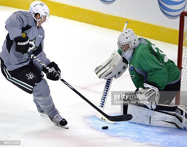 The Dallas Stars' Shawn Horcoff left takes the puck to the goal as goalie Richard Bachman defends during the team's practice session at the Fort...