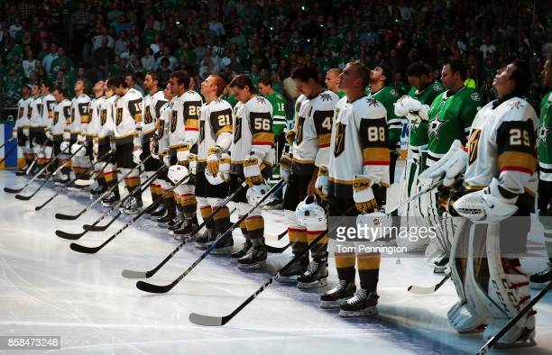 The Dallas Stars stand behind the Vegas Golden Knights on the ice during the National Anthem at American Airlines Center on October 6, 2017 in...