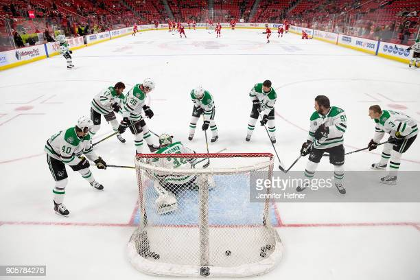 The Dallas Stars surround teammate goaltender Kari Lehtonen during warmups prior to an NHL game against the Detroit Red Wings at Little Caesars Arena...