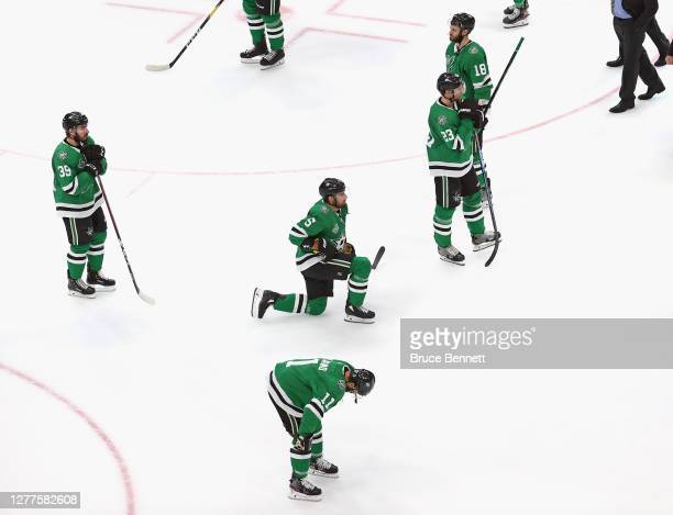 The Dallas Stars wait for the handshake line with the Tampa Bay Lightning following their loss in Game Six of the 2020 NHL Stanley Cup Final at...
