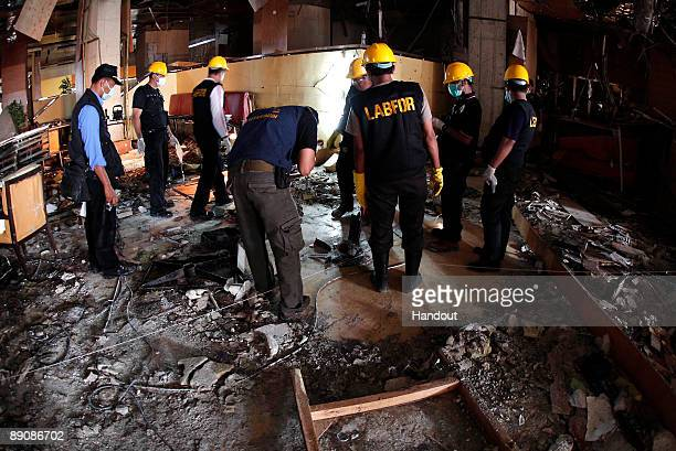 The damage inflicted by a bomb blast on a restaurant of the JW Marriot hotel is seen on July 18 2009 in Jakarta Indonesia At least nine people...