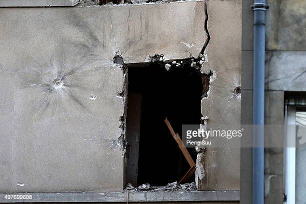 The damaged building that was raided earlier in the morning is pictured on November 18, 2015 in Saint-Denis, France.. French Police special forces...
