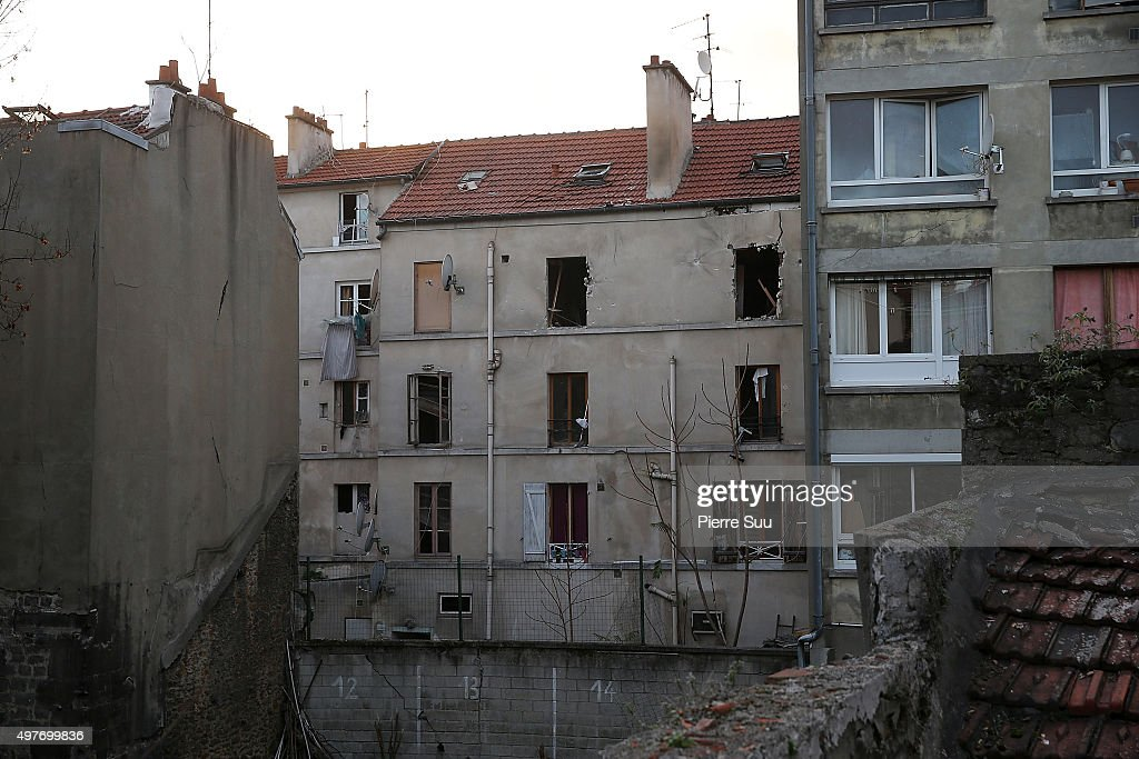 The damaged building that was raided earlier in the morning is pictured on November 18, 2015 in Saint-Denis, France. French Police special forces raided an apartment, hunting those behind the attacks that claimed 129 lives in the French capital five days ago. At least one person was killed in an apartment targeted during the operation aimed at the suspected mastermind of the attacks, Belgian Abdelhamid Abaaoud. At least five police officers have been wounded in the shootout.