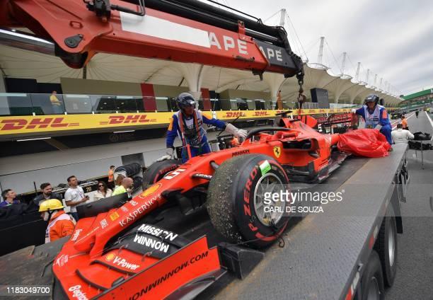 The damaged car of Ferrari's German driver Sebastian Vettel arrives in boxes during the F1 Brazil Grand Prix at the Interlagos racetrack in Sao Paulo...