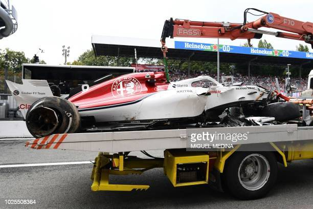 The damaged car of Sauber F1's Swedish driver Marcus Ericsson is transported on a truck following a crash during the second practice session at the...