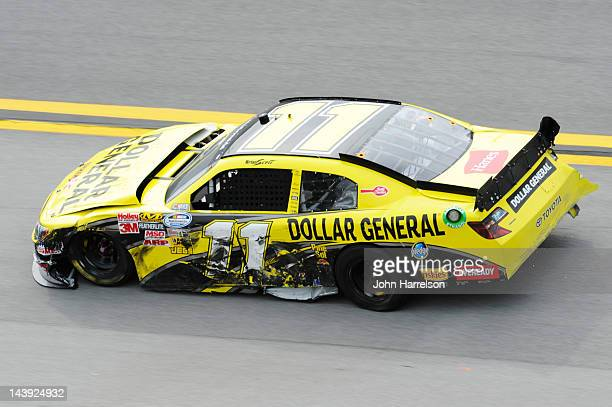 The damaged Dollar General Toyota of Brian Scott is driven on the apron after an on track incident during the NASCAR Nationwide Series Aaron's 312 at...