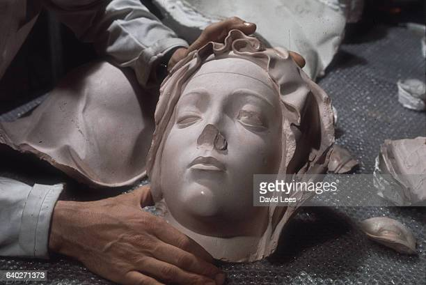The damaged face of the Virgin Mary from Michelangelo's Pieta at St Peter's Rome prior to restoration
