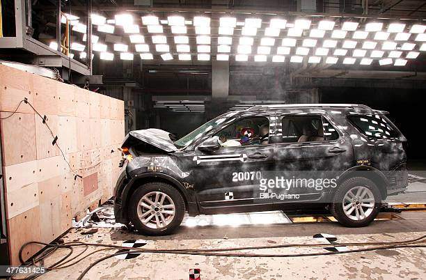 The damaged front of a 2014 Ford Explorer XLT sits after a fullfrontal crash impact test into a wall at 30mph at the Crash Barrier Dearborn...