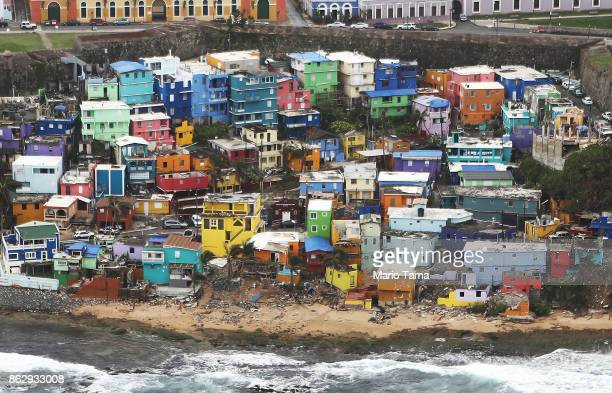 The damaged La Perla neighborhood is viewed from the air during recovery efforts four weeks after Hurricane Maria struck on October 18 2017 inflight...