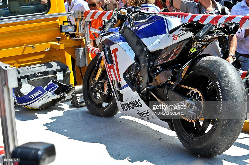 The damaged motor bike of Italy's Valentino Rossi of Yamaha stands on the truck after a crash during the Italian Grand Prix at Mugello track on June 5, 2010. Valentino Rossi of Yamaha fractured his right shin bone in a crash during the free practice, ruling him out of tomorrow's Italian MotoGP. The 31-year-old nine-time world champion - seven of them at this level, comprising six at MotoGp and one at 500cc - had been fastest in practice despite still suffering the effects of a shoulder injury.