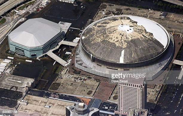 The damaged roof from Hurricane Katrina of the Louisiana Superdome is seen August 30 2005 in New Orleans Louisiana Approximately 100 people are...