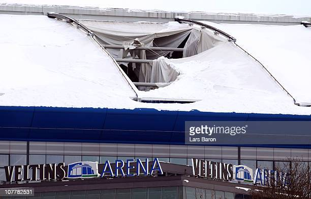 The damaged roof of the Veltins Arena is seen on December 26, 2010 in Gelsenkirchen, Germany. The Biathlon World Team Challenge scheduled for...