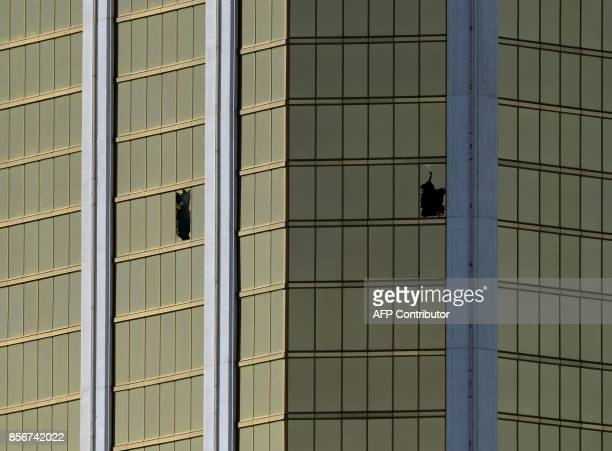 The damaged windows on the 32nd floor room that was used by the shooter in the Mandalay Hotel after a gunman killed at least 58 people and wounded...
