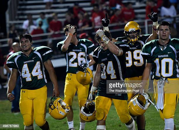The Damascus players walk off the field after winning the season opener between Damascus and Quince Orchard High Schools at Damascus on Friday...
