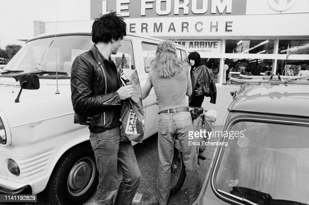 The Damned's tour van parked outside a French supermarket, October 1977. L-R Brian James, the band's tour manager, Laurie Vanian.