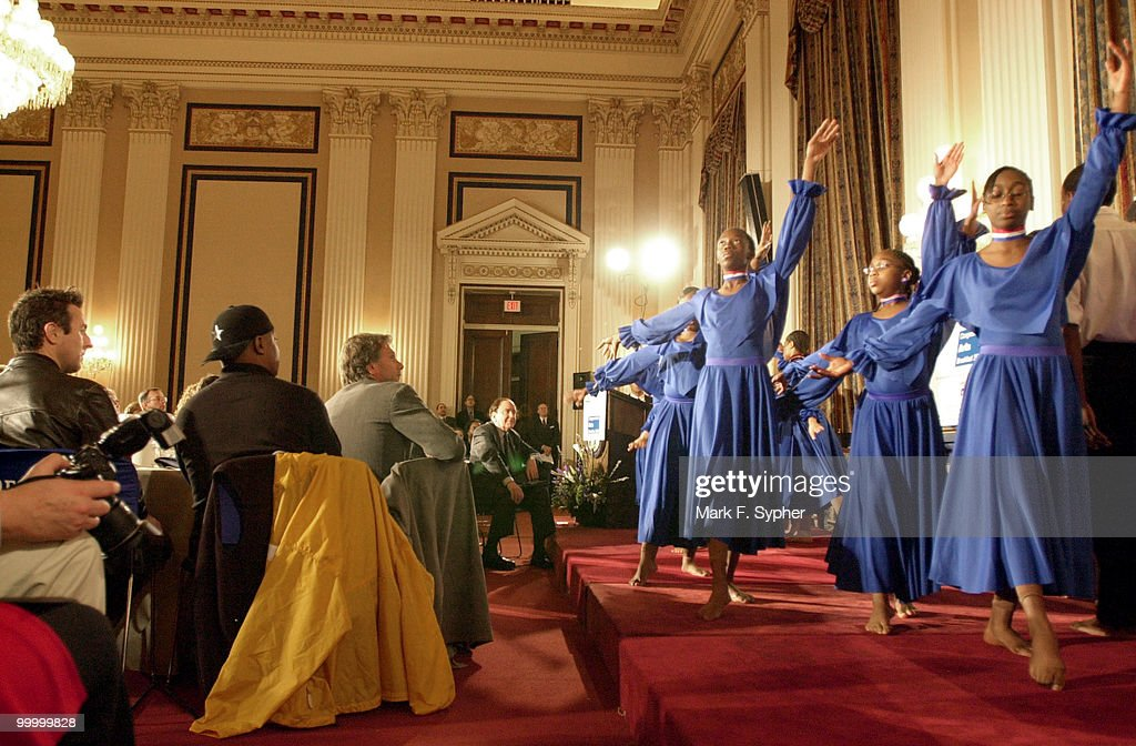 The dance group, 'The Artists Collective' performed a routine barefoot in the Cannon Caucus Room on Tuesday morning before a host of celebrities and lawmakers. Watching from left, Alan Cumming (Cabaret, Titus), Chuck D and Peter Horton (30 Something).
