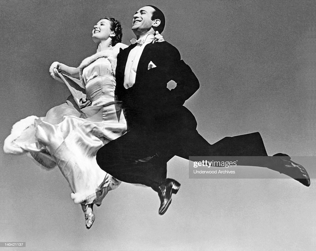 The dance team of Galante and Leonarda execute one of their 'flight maneuvers' in their swing version of the rhumba, Hollywood, California circa 1932.