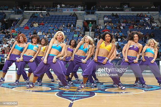 The dance team of the New Orleans Hornets perform during the game against the Charlotte Bobcats on March 12 2012 at the New Orleans Arena in New...