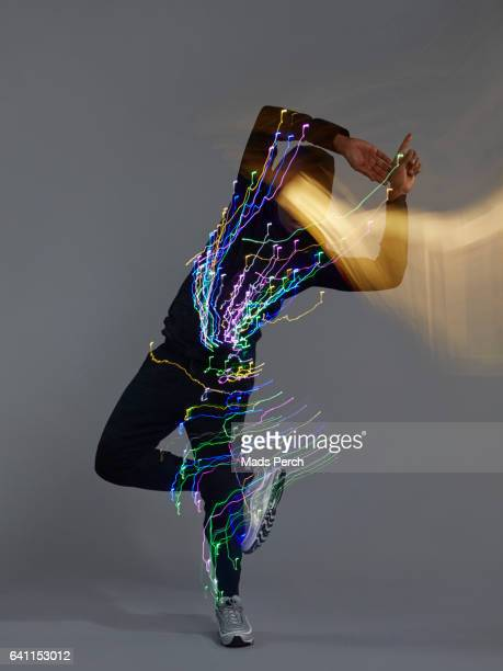 The Dancer has led lights attached to him, while moving around fast he creates the burst of light