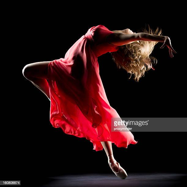 the dancer on black background - performance stock pictures, royalty-free photos & images