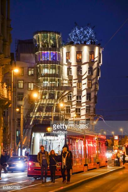 The Dancing House or Fred and Ginger is the nickname given to the NationaleNederlanden building on the Raínovo nábeí in Prague Czech Republic