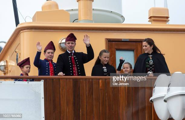 The Danish Crown Prince family is waving to the spectators during The Royal Danish ship Dannebrog approach to Klaksvig at the second day of the Royal...