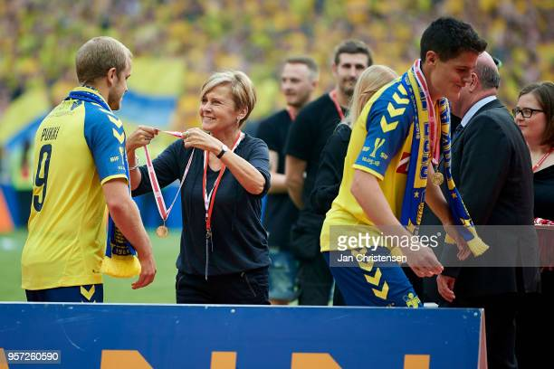 The Danish Minister for Culture Mette Bock overrides gold medal for Teemu Pukki of Brondby IF after the Danish Cup Final DBU Pokalen match between...