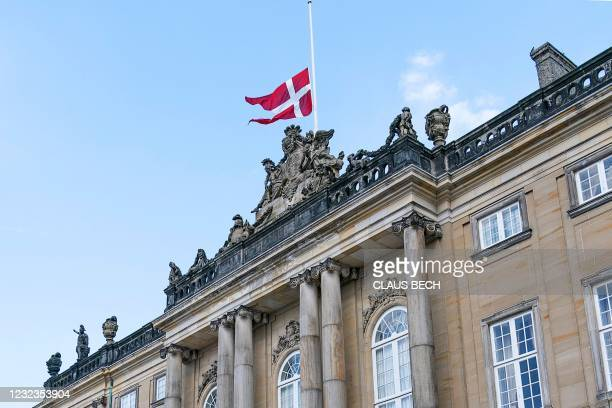 The Danish national flag flies at half mast at Amalienborg Palace in Copenhagen on April 17 on the occasion of the funeral of Britain's Prince...