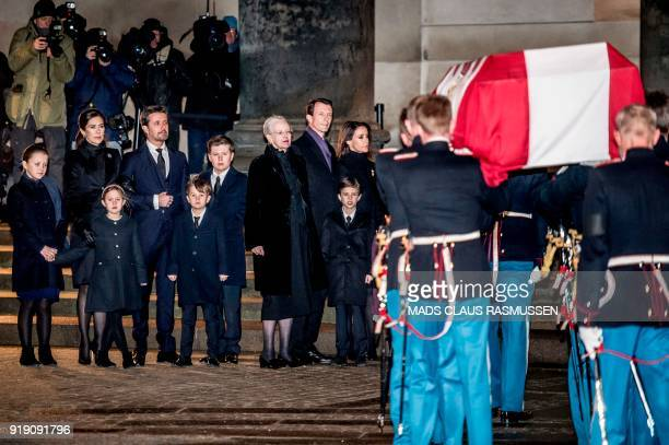 The Danish royal family waits outside Christiansborg Palace Church for the bier of Prince Henrik on February 16, 2018 in Copenhagen. - From February...