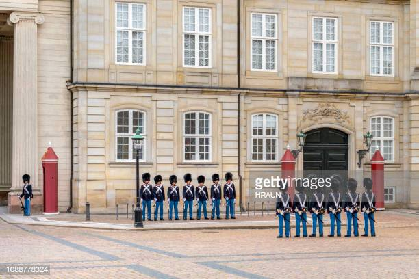 the danish royal life guards at amalienborg palace - palace stock pictures, royalty-free photos & images