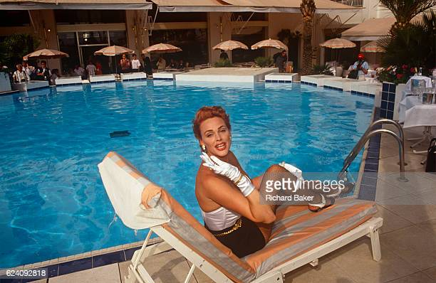 The Danishborn actor Brigitte Nielsen seen poolside at the Cannes Film Festival on 10th May 1992 at Cannes France Brigitte Nielsen is a...