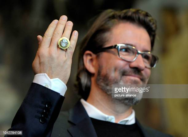 The danishicelandic artist Olafur Eliasson shows his ringed hand after being awarded with the Kaiserring 2013 international art prize in Goslar...
