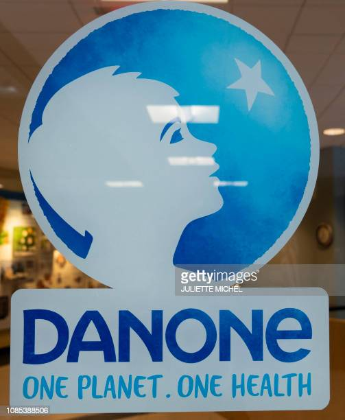 The Danone company logo is displayed at the entrance at Danone's pilot plant in White Plains New York on January 7 2019 At Danone's pilot plant in...