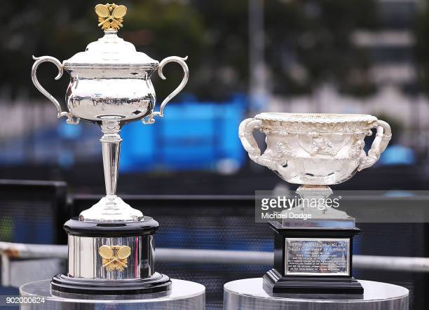 The Daphne Akhurst Memorial Cup for Women and the Norman Brookes Memorial Cup for Men are seen ahead of the 2018 Australian Open at Melbourne Park on...