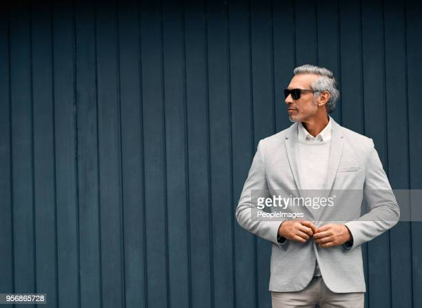 the dapper businessman - gray suit stock pictures, royalty-free photos & images