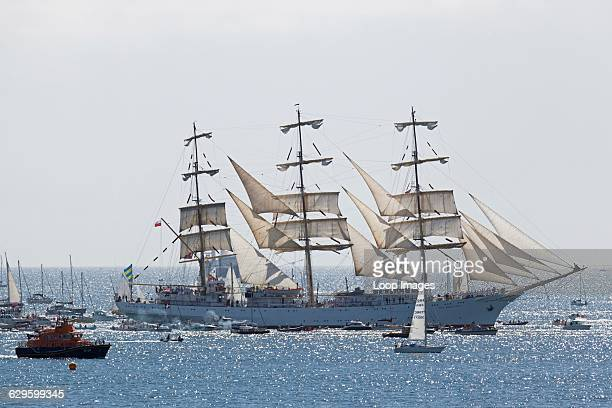 The Dar Mlodziezy in the parade of sail prior to the 2014 Tall Ships race Falmouth England