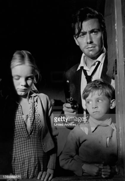 Der Mann in Schwarz Großbritannien 1951 Regie Jeffrey Dell Darsteller Maxwell Reed