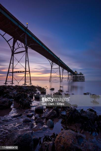 the dark side of the pier - clevedon pier stock pictures, royalty-free photos & images
