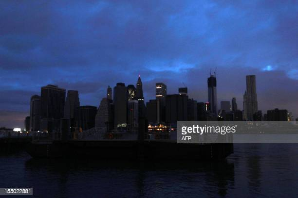 The darkened skyline of lower Manhattan is seen one day after Hurricane Sandy on October 30 2012 Life ground to a virtual halt in parts of southern...