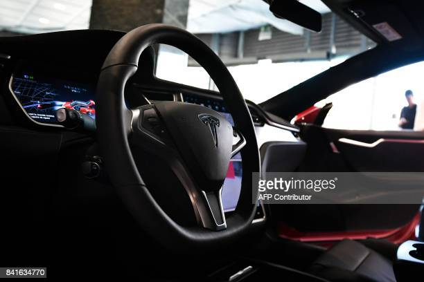 The dashboard of the Tesla Model S car is pictured at the electric carmaker Tesla showroom of El Corte Ingles store in Lisbon on September 1 2017 /...