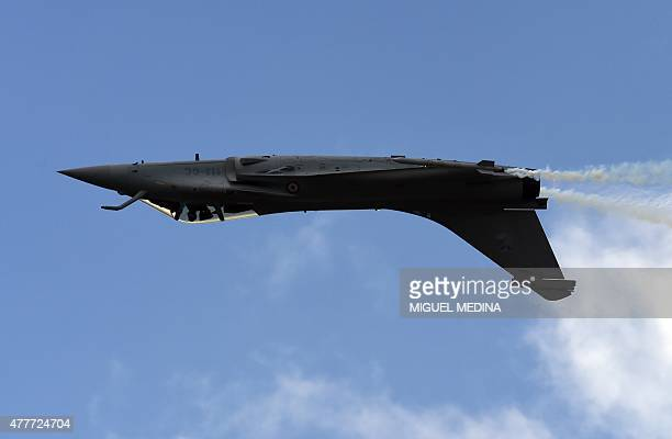 The Dassault Rafale fighter jet performs its flying display on the first public day at the International Paris Airshow at Le Bourget on June 19,...