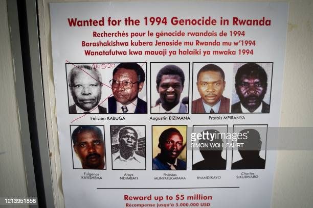 The date of arrest and a red cross are seen written on the face of Felicien Kabuga one of the last key suspects in the 1994 Rwandan genocide on a...