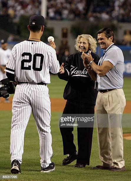 The daughter of Babe Ruth Julia Ruth Stevens accepts the ball from Jorge posada after throwing out the ceremonial first pitch as grandson Tom Stevens...