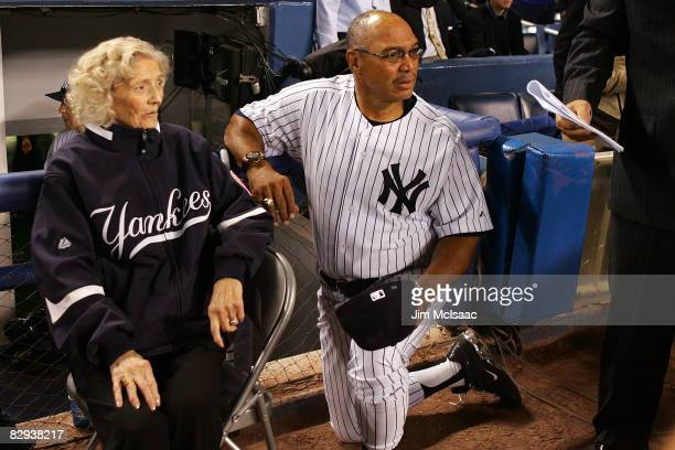 The daughter of Babe Ruth Julia Ruth Stevens and Reggie Jackson look on during a pregame ceremony prior to the start of the last regular season game...