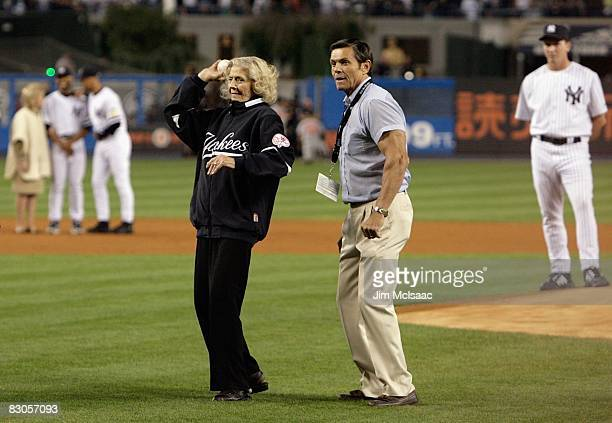 The daughter of Babe Ruth Julia Ruth Stevens throws out the ceremonial first pitch as grandson Tom Stevens looks on during pregame ceremonies prior...