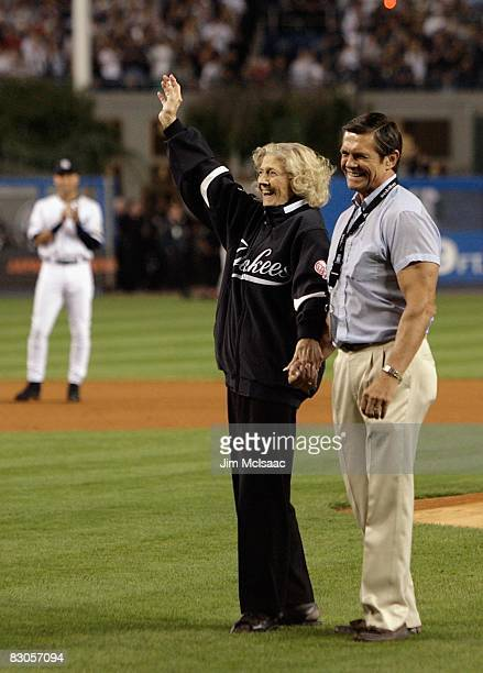The daughter of Babe Ruth Julia Ruth Stevens waves to the crowd after throwing out the ceremonial first pitch as grandson Tom Stevens looks on during...